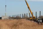 JadeWeserPort: Montage der Beton-Lärmschutzwand im Voslapper Groden